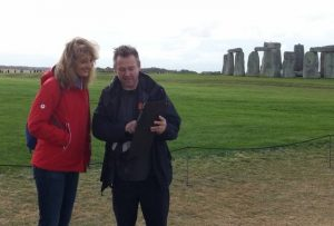 Your Stonehenge guide Laurence explaining with iPad