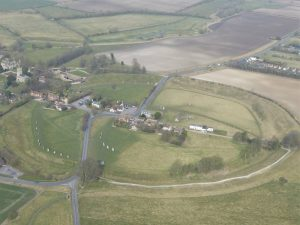 Avebury from the air. Keiller's reconstructed sections are on the left, the SW and NE quadrants