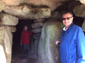 Inside West Kennet Long Barrow with customers on Oldbury Tours Private Tour