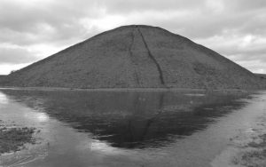 Silbury Hill Reflected in late winter water with Oldbury tours