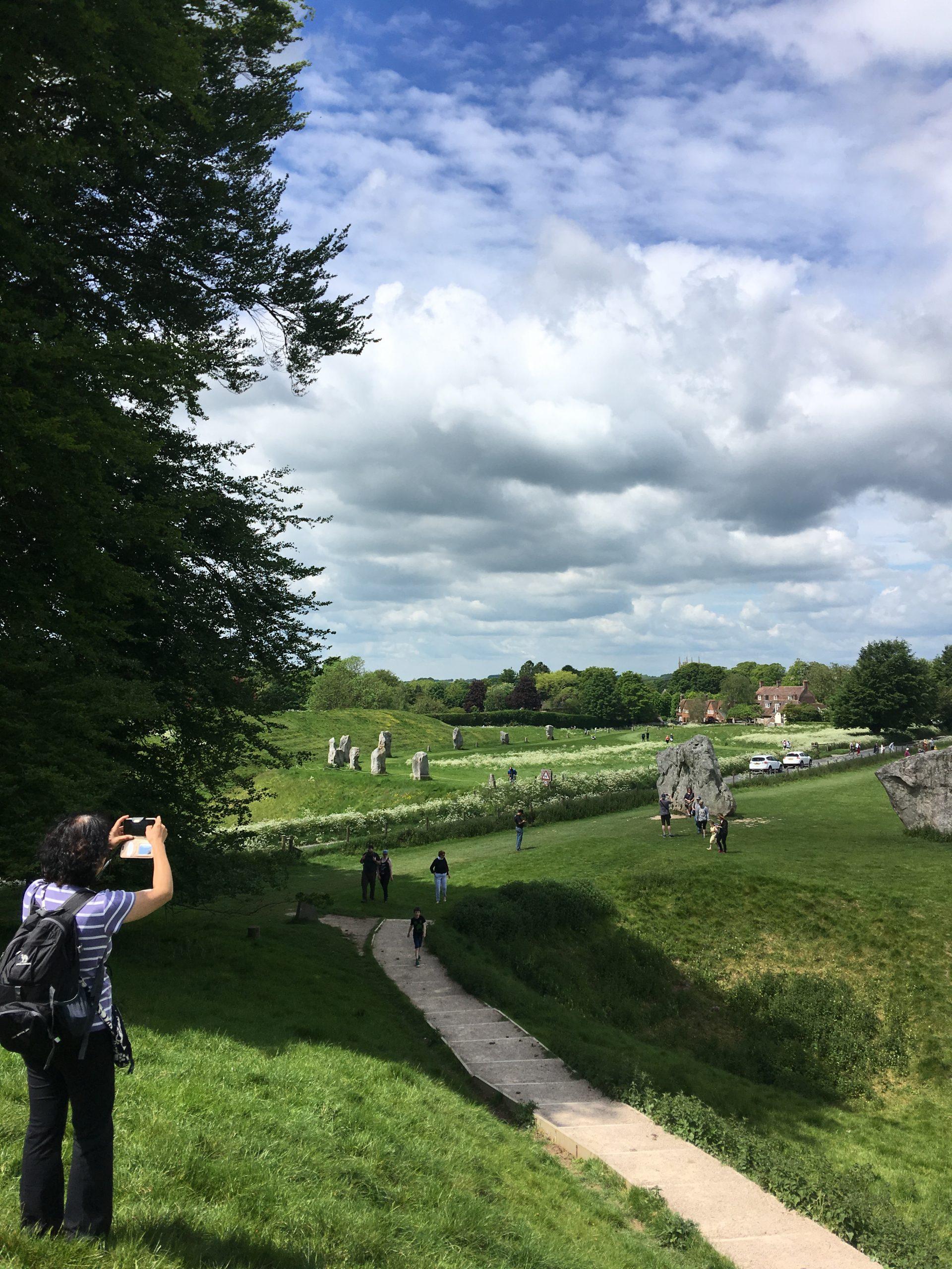 On the bank at Avebury on an Avebury Stone Circle tour