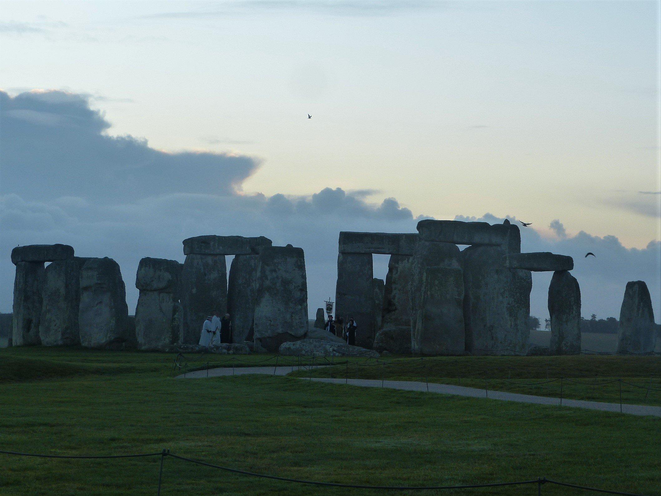 People congregating inside Stonehenge in winter