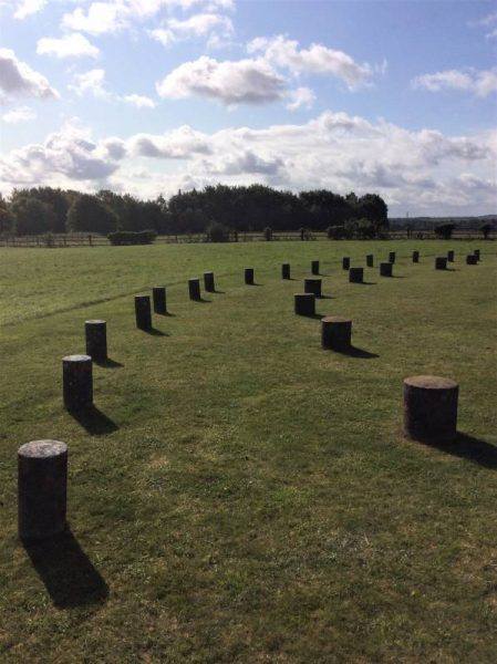 Concrete markers mark the place of huge timber posts that once stood at Woodhenge, Wiltshire, UK