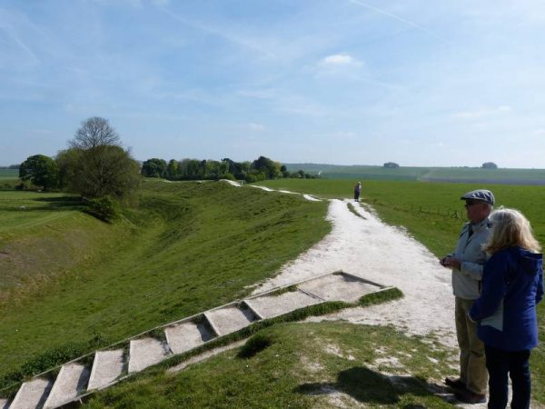 Avebury and Stonehenge guided tours - Couple on top of the bank of Avebury Henge, Wiltshire with Oldbury Tours
