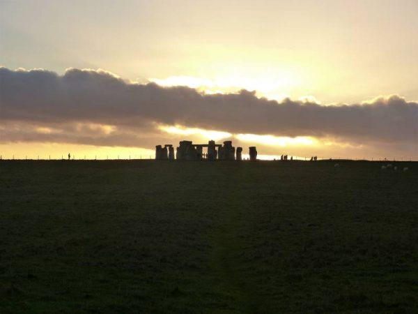 Stonehenge half day tour -  the setting midwinter sun, Stonhenge, Wiltshire, UK