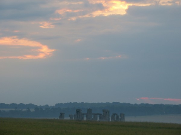 Your Stonehenge guide - Midsummer dawn at Stonehenge viewed from near Bush Barrow, Normanton Down, Wiltshire, UK