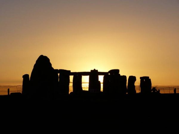 Avebury and Stonhenge guided tours - looking at the sunning setting behind Stonehenge in midwinter
