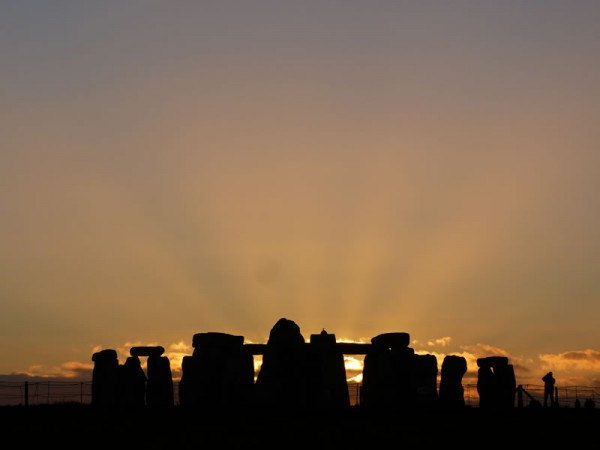 Your Stonehenge guide - the midwinter sun setting behind Stonehenge
