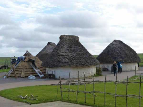Stonehenge half day tour - replica neolithic houses at the Stonehenge visitor centre