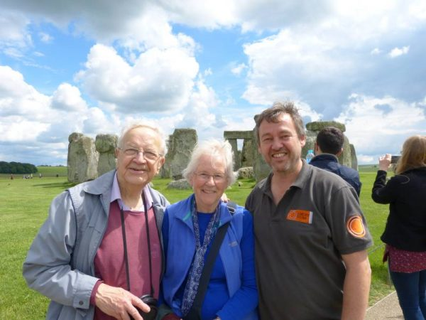 Laurence with clients at Stonehenge