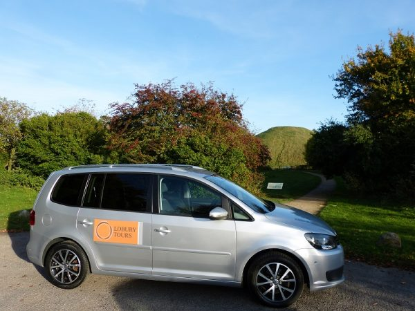 Oldbury Tours VW Touran parked at Silbury Hill