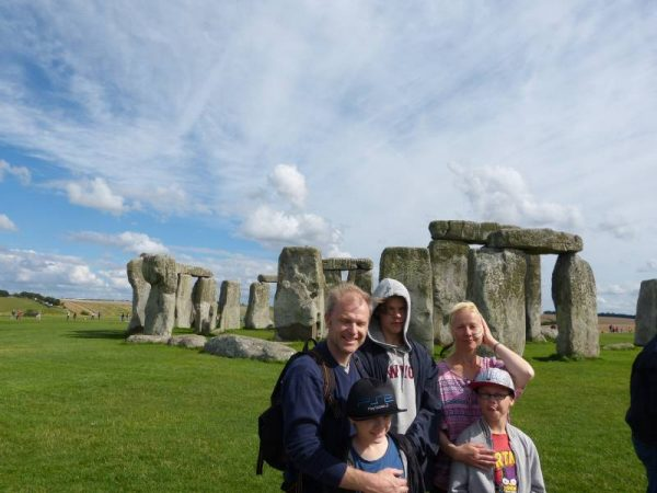 Stonehenge private guided tours - young family at Stonehenge, Wiltshire with Oldbury Tours