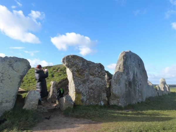 Avebury half day tour: At the entrance of West Kennet Long Barrow, Wiltshire, UK