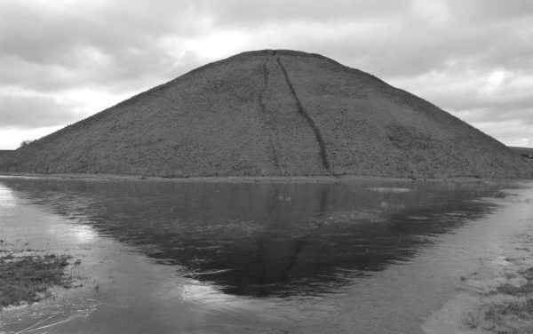 Avebury half day tour: Silbury Hill reflected in its waters, Wiltshire, UK