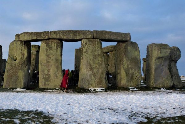 People congregating inside Stonehenge in winter