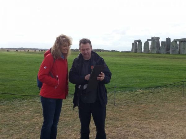 Laurence with iPad at Stonehenge